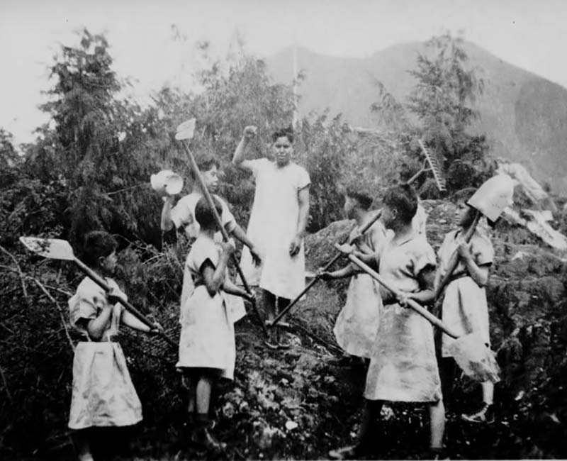 Christie Tofino group of students holding gardening tools