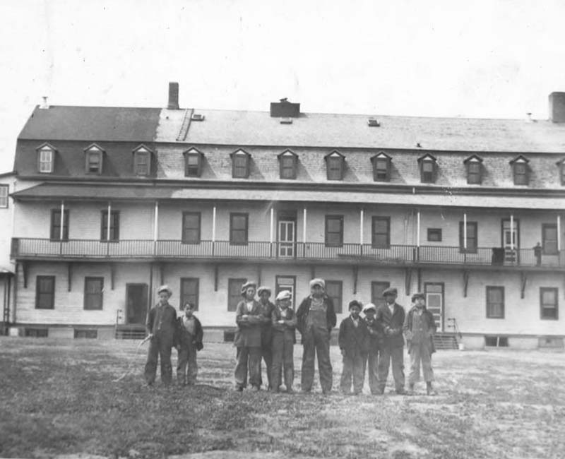 Group of students outside building at Ermineskin Hobbema school