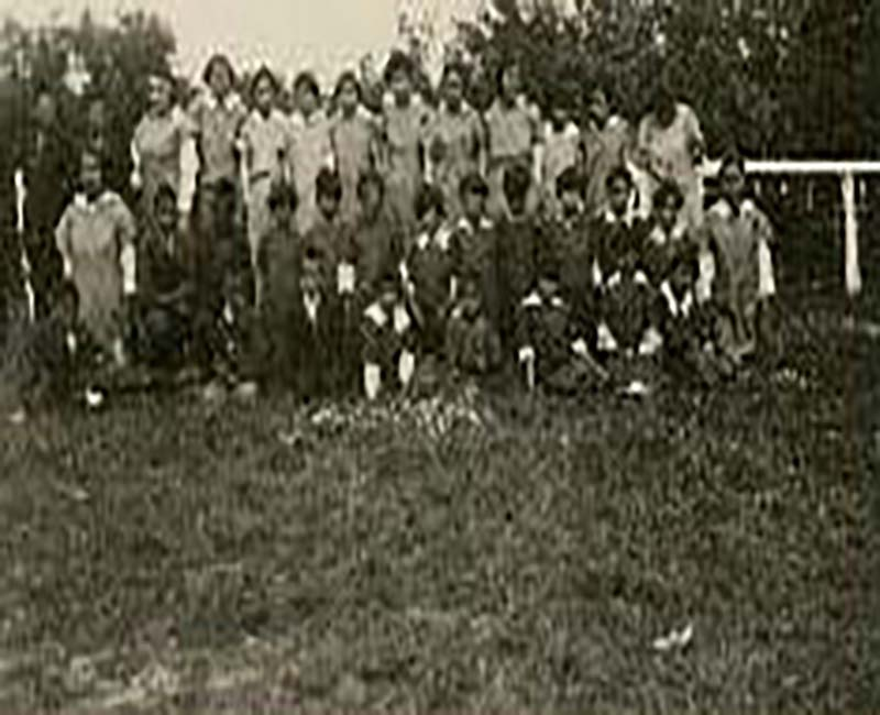 Group of people outside of Fire Hills school