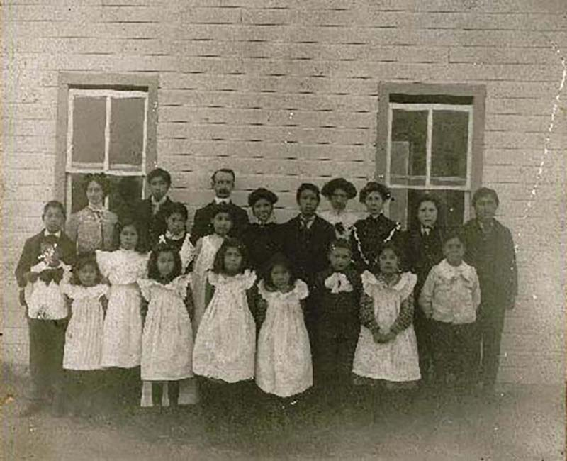 Group of people in front of Fire Hills school