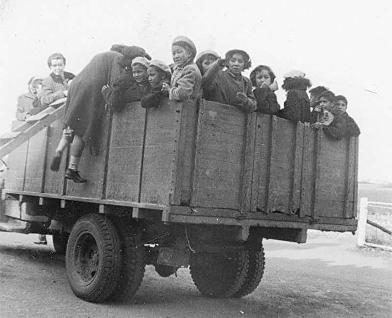 Group of children in wagon at Gordon's school