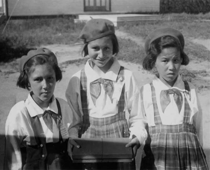 Three students outside at Holy Angels Fort Chipewyan School