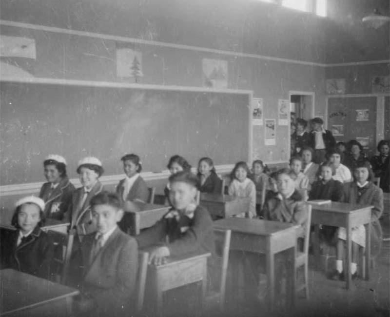 Students sitting at desk in Kupersland school
