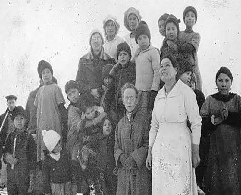 Group of people posing for photo from Lesser Slave Lake school