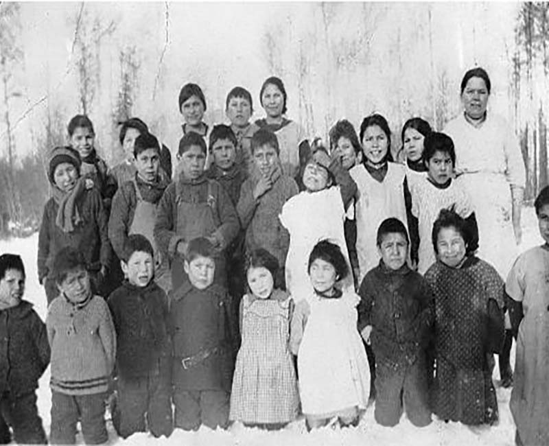 Group of students and teacher outside at Lesser Slave Lake school