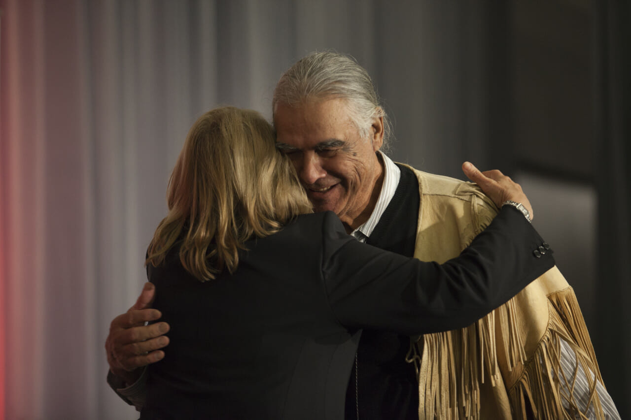 People hugging at TRC closing ceremony