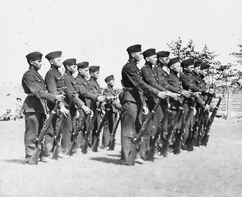 group of people outside of Prince Albert school in uniforms