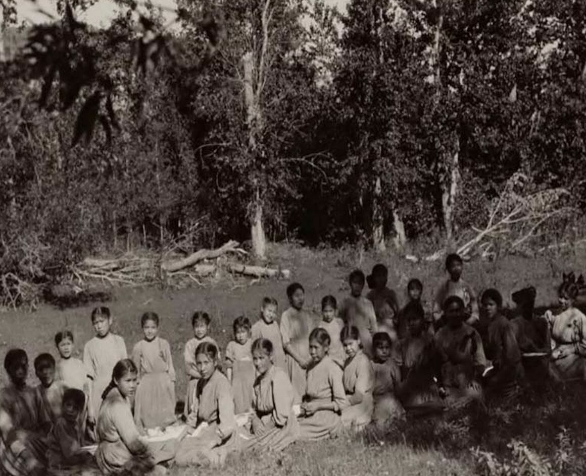 group of students sitting outside Lejac Stuart Lake school