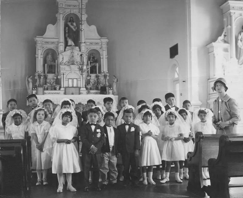 group of students standing in church from Sechelt St. Augustines School