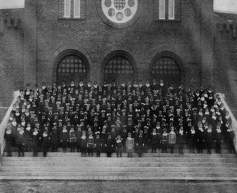 Students in front of St. Albert Youville school building