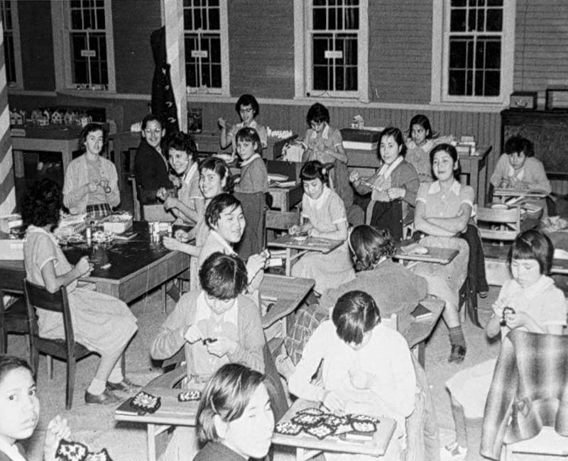 Students at desks in St. Georges school