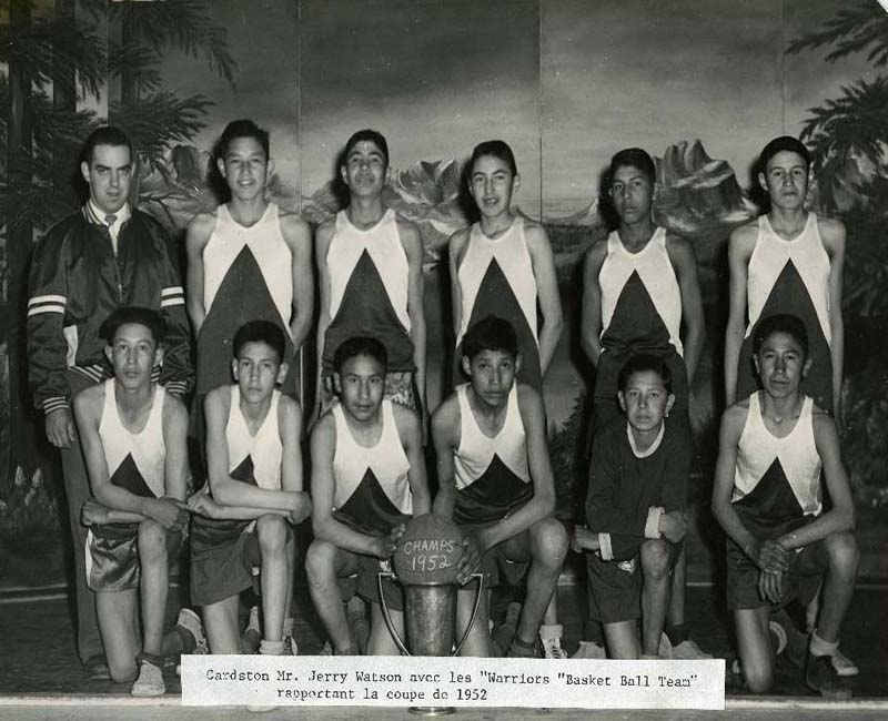Basketball players posing for photo at St. Mary's Blood school