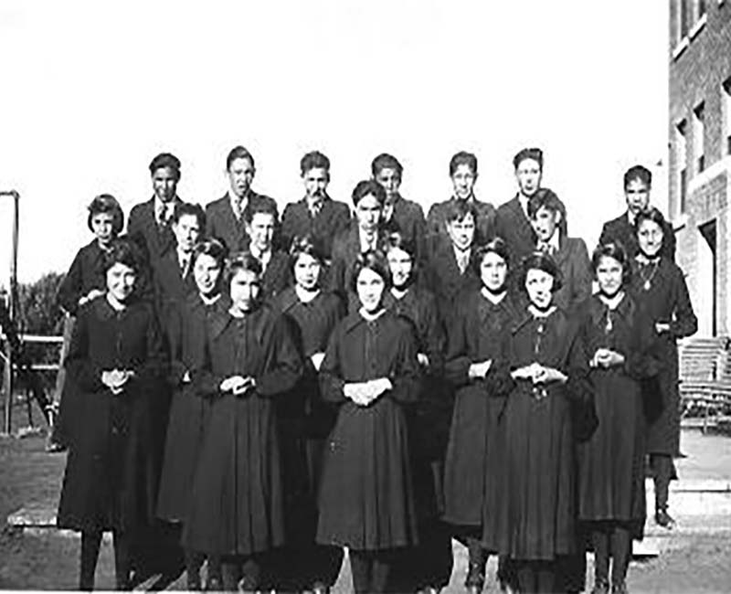 group of people outside St. Michaels Duck Lake school