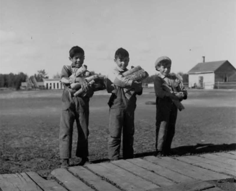 Three students outside at Sturgeon Lake Calais school