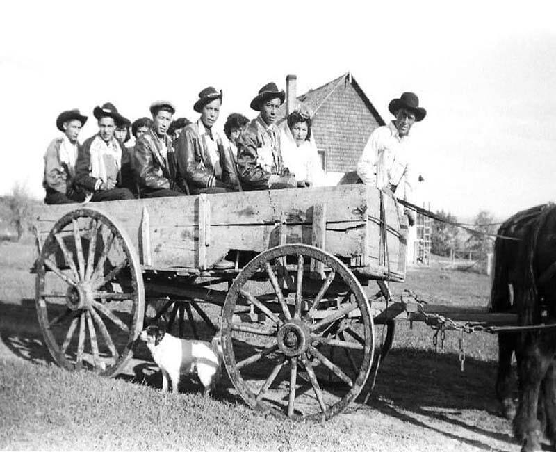 group of people in wagon outside at Wabasca St. Johns school