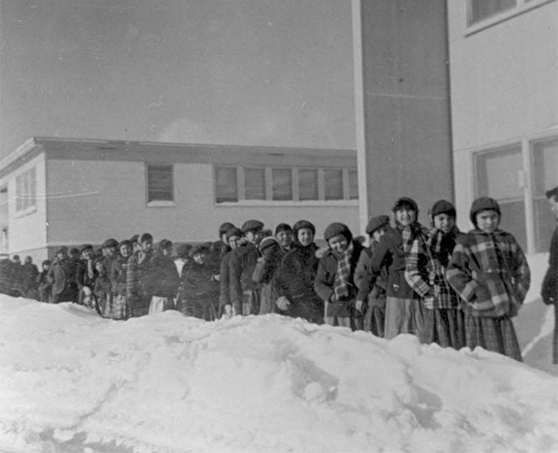 Group of children outside in snow at Bishop Horden Hall school