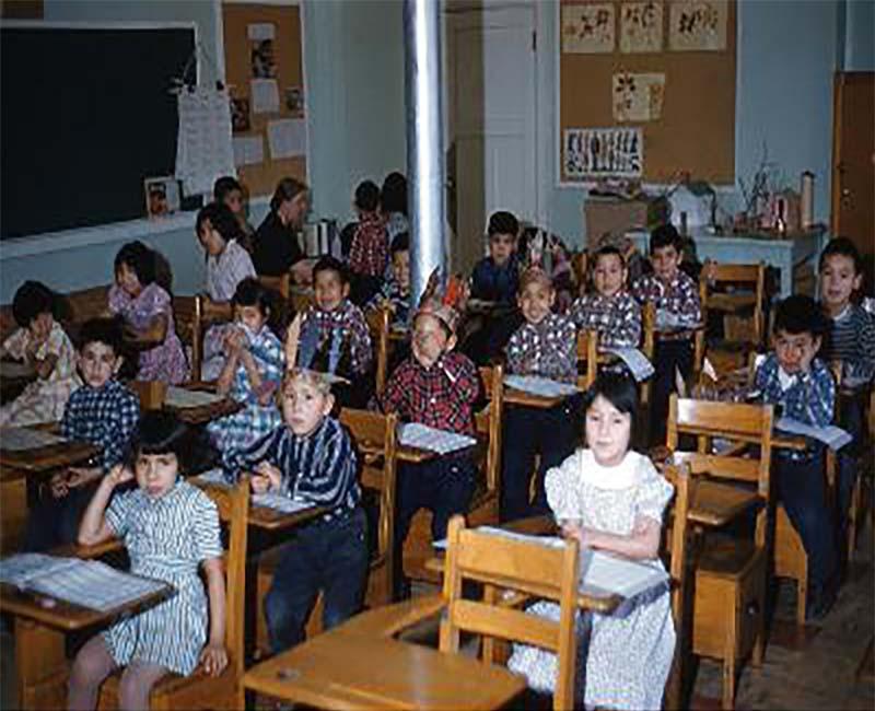 Group of students sitting in rows of desks in Brandon school