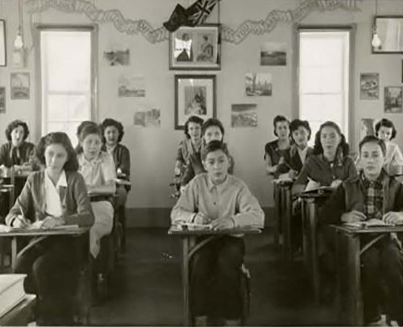 Students sitting at desks in Breynat Hall school