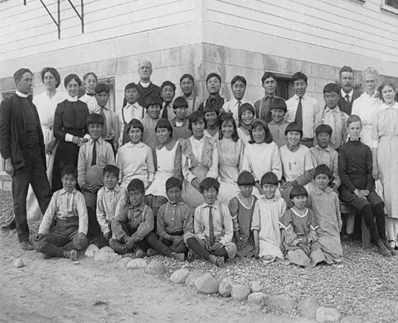 Group of people posing for photo by Carcross Chooutla school
