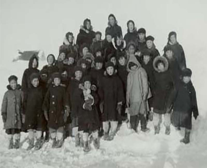 Group of students outside in the snow