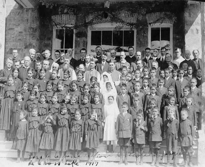 Group of students and teachers in front of Cross Lake school