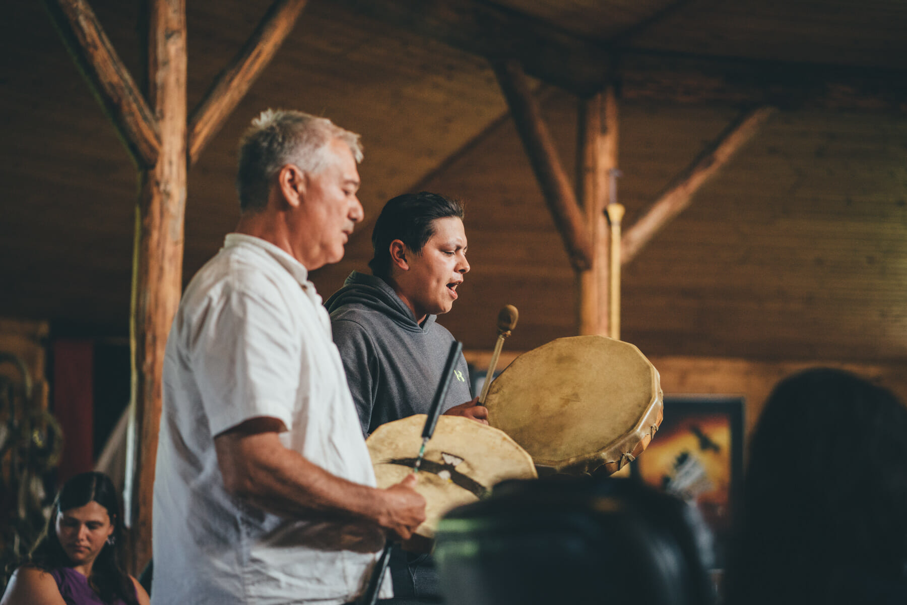 Two people drumming in Turtle Lodge