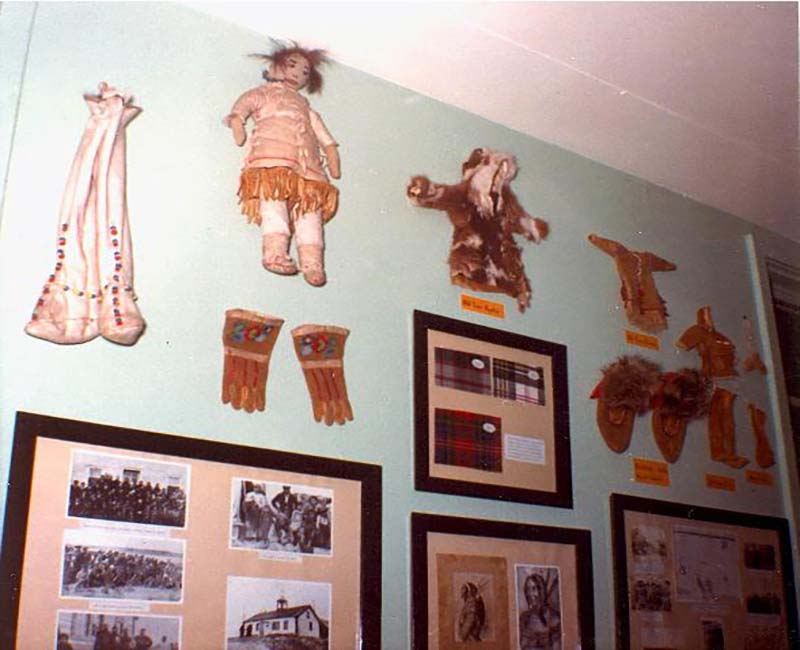 Photos and artifacts hanging on wall at Federal Hostel at Eskimo Point