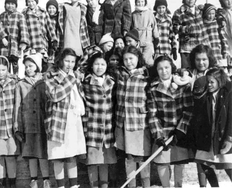 group of students outside Fort Alexander Pine Falls school