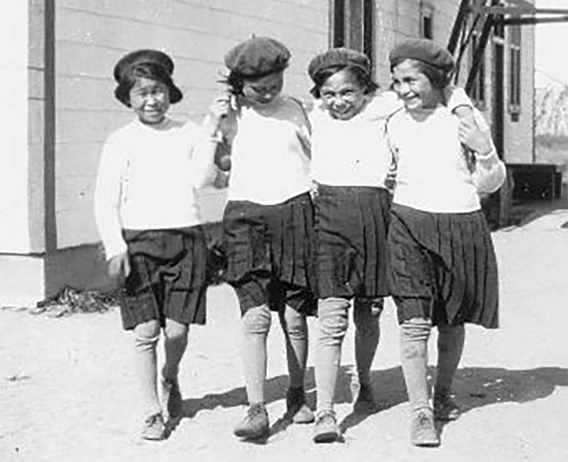 Four students walking outside at Fort George Church of England school