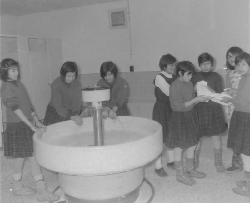 Students washing hands at Fort George Roman Catholic school