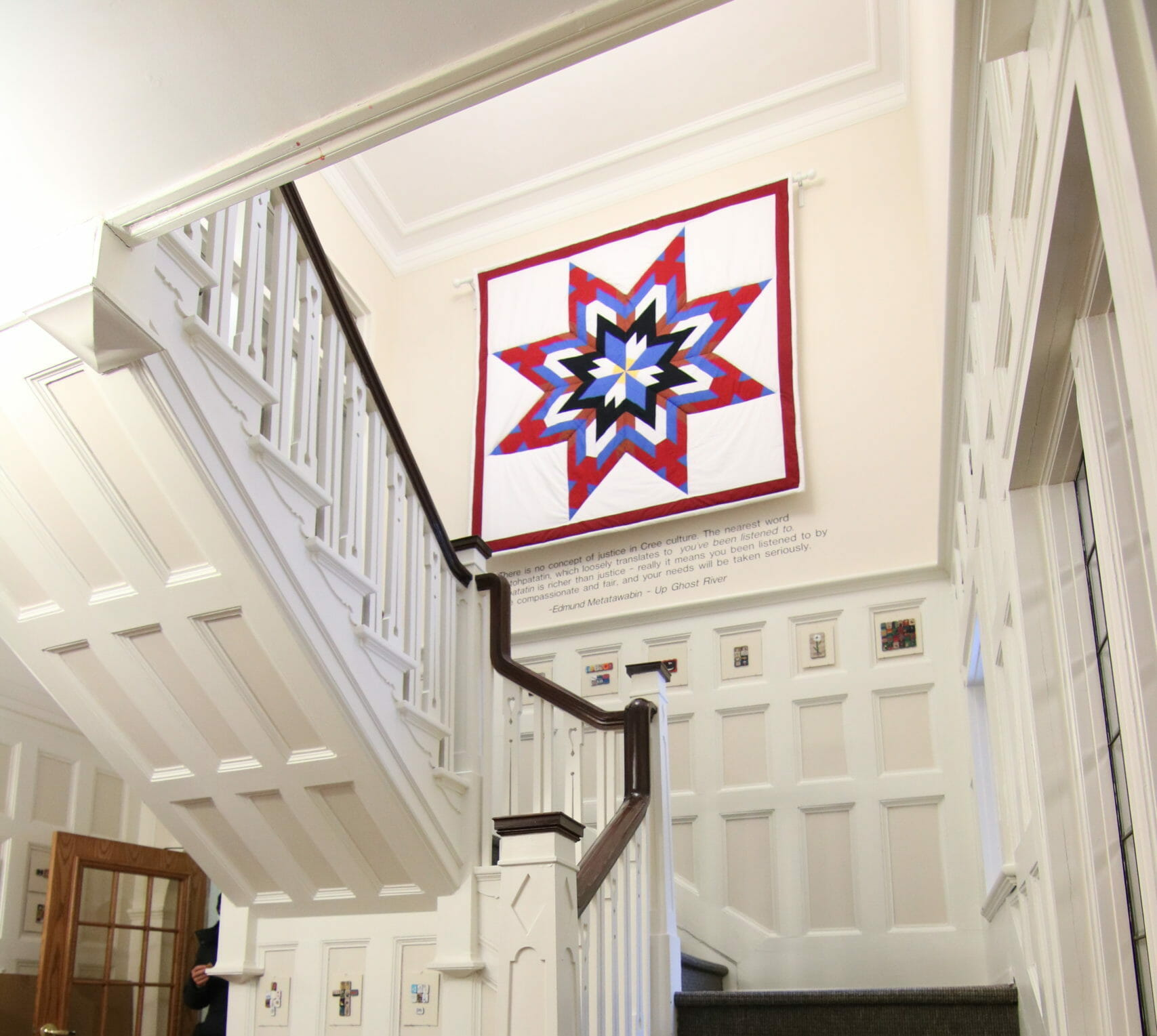 Star blanket hanging in staircase at NCTR building