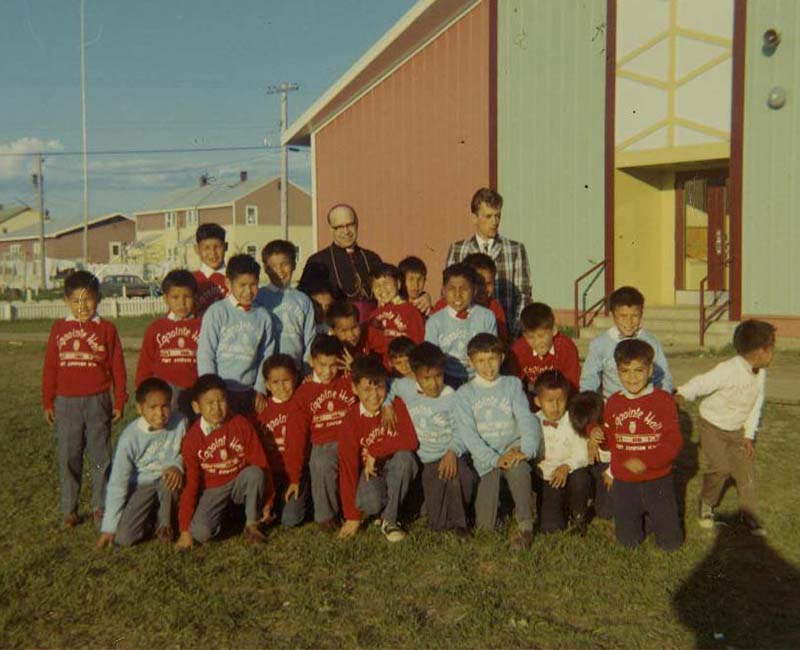 Students and teachers outside at Federal Hostel at Pond Inlet