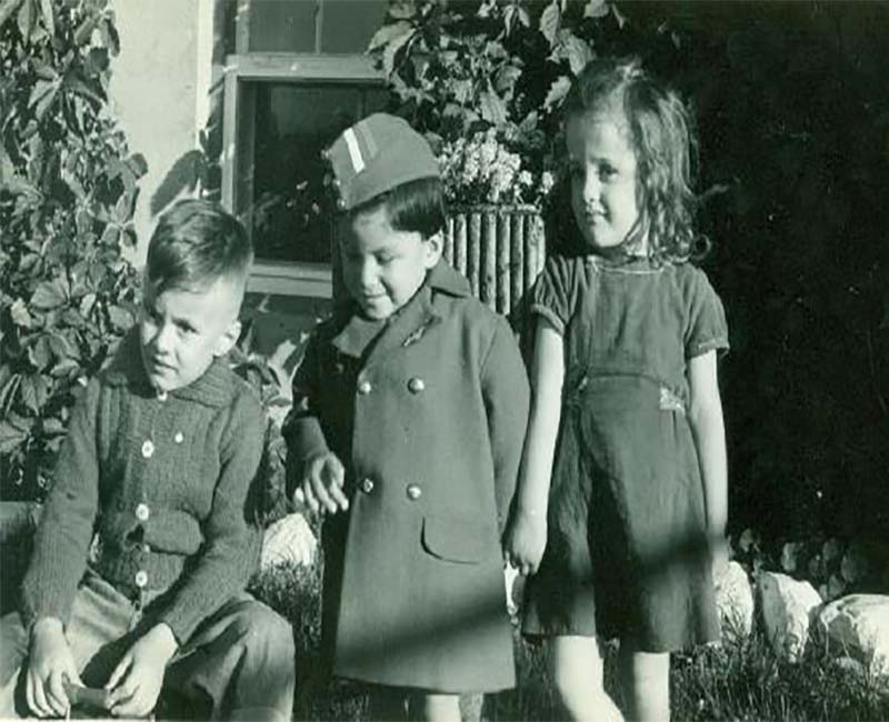 Three students outside posing for picture from McIntosh school