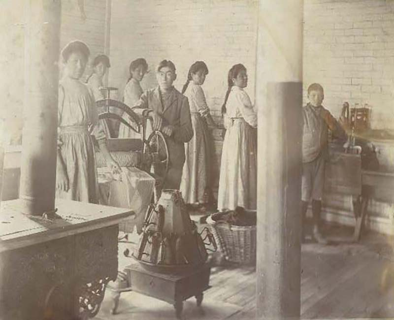 Group of people doing laundry in Mount Elgin school
