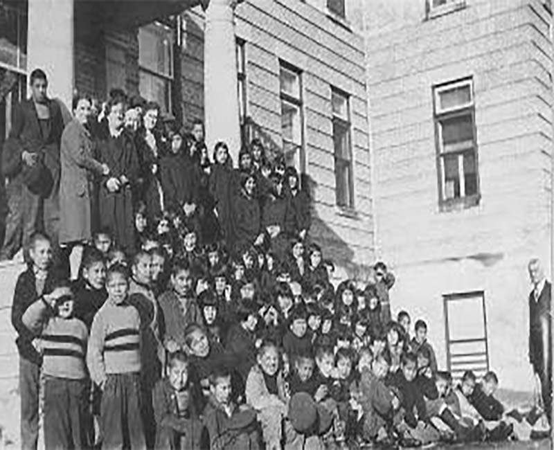 Group of students posed for photo outside Norway House school