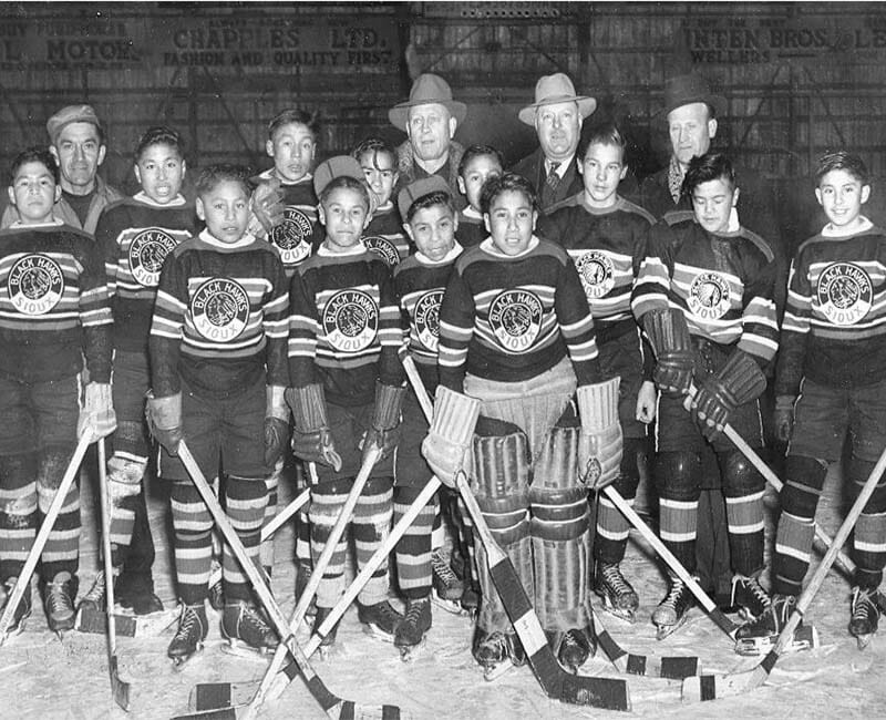 Hockey team posing for photo
