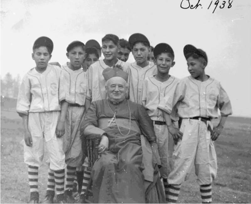 Group of students in baseball outfits from Pine Creek school