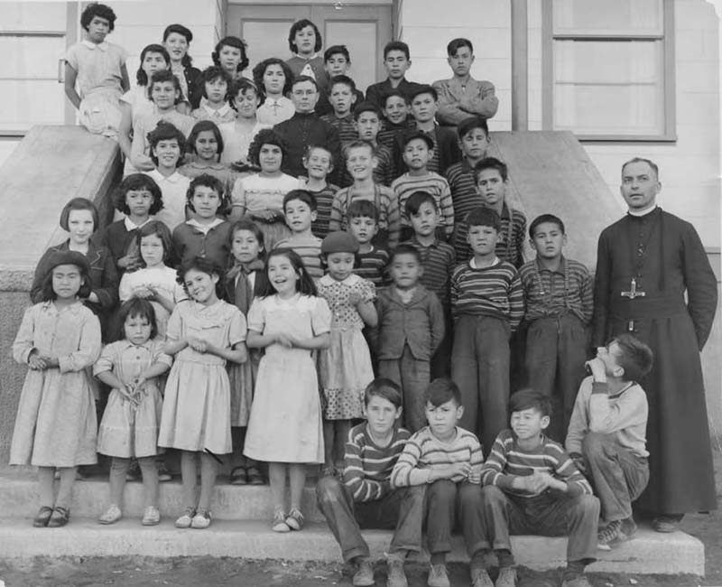 Students and teacher posing for photo in front of Sept-Iles school