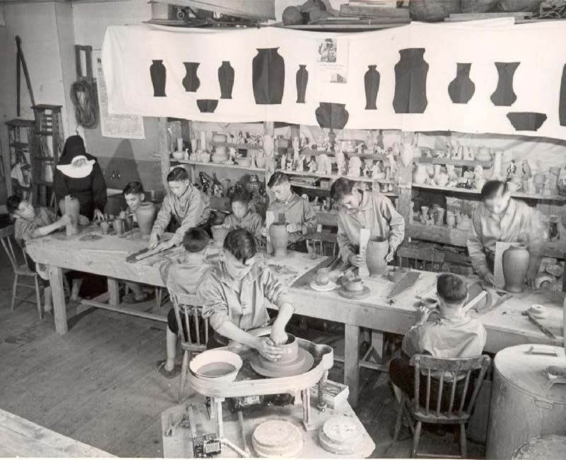 group of people making pottery at Shubenacadie school