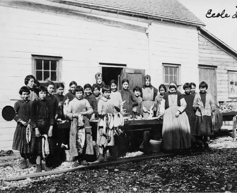 Group of students and teachers outside Coudert Hall school