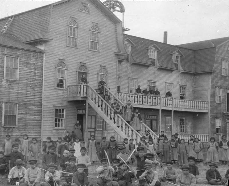 Group of students and teachers outside St. Joseph Fort Resolution school building