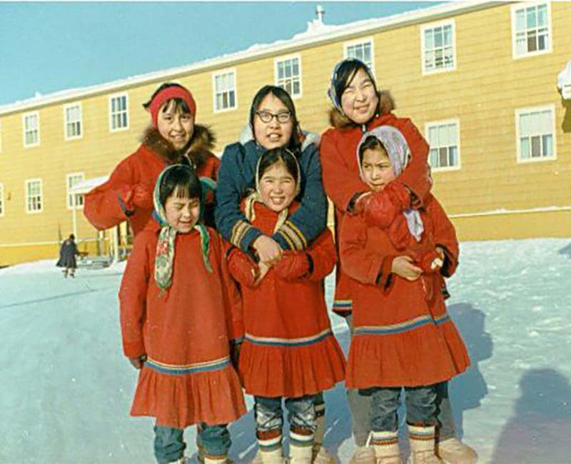 Group of students outside Stringer Hall Inuvik school