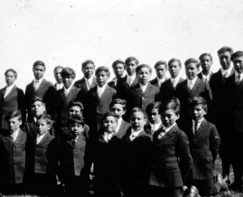 Group of students posed for picture outside of Sturgeon Landing school