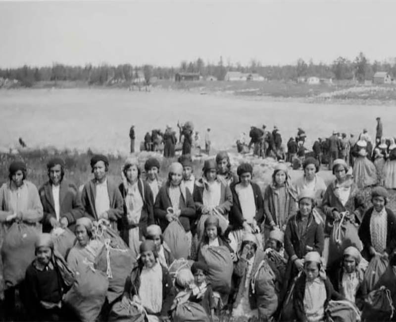 Group of people outside from Sturgeon Landing school