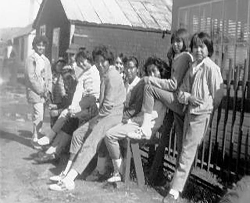 Group of students outside Yukon Hall Whitehorse school