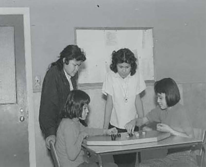 Group of four students playing a game in Yukon Hall Whitehorse school