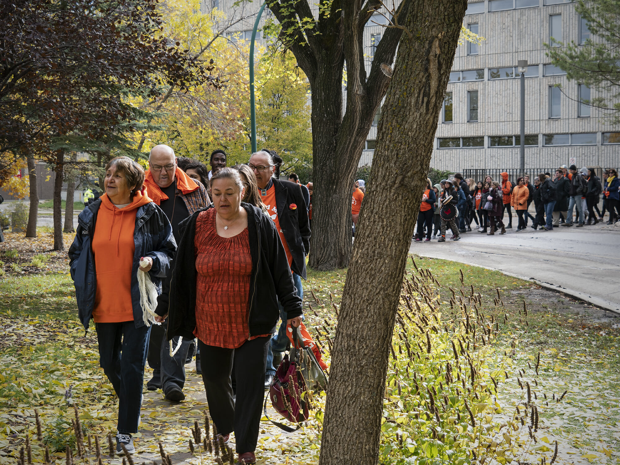 People participating in Orange Shirt Day nurses walk