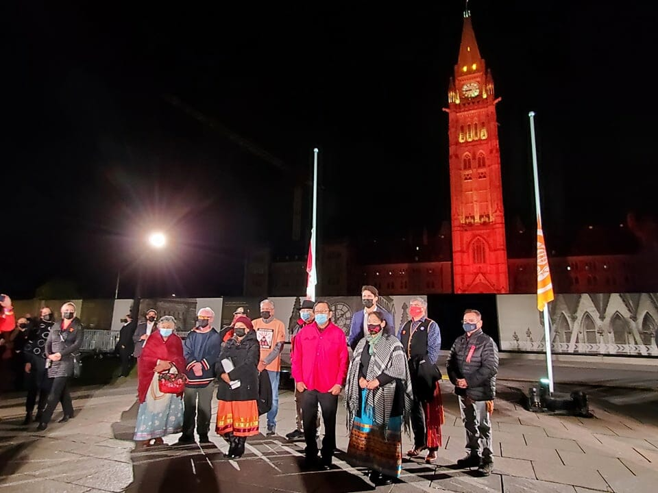 Survivors stand on Parliament Hill